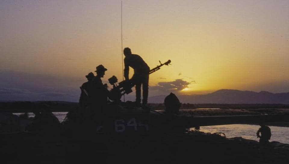 Soviet soldiers stand atop of a tank during sunset in Afghanistan in September 1984. Like Russia's campaign in Syria, the Afghan war is widely perceived as legitimate action against US-backed militants. And in a twist of history, Russia has emerged as an influential power broker, mediating between Afghan factions and jockeying for influence amid a US-led coalition embroiled for more than 17 years. (Alexander Zemlianichenko / AP File)