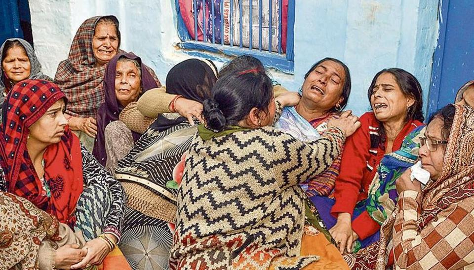 Family members mourn the death of CRPF jawan Koushal Kumar Rawat, in Agra on Friday.