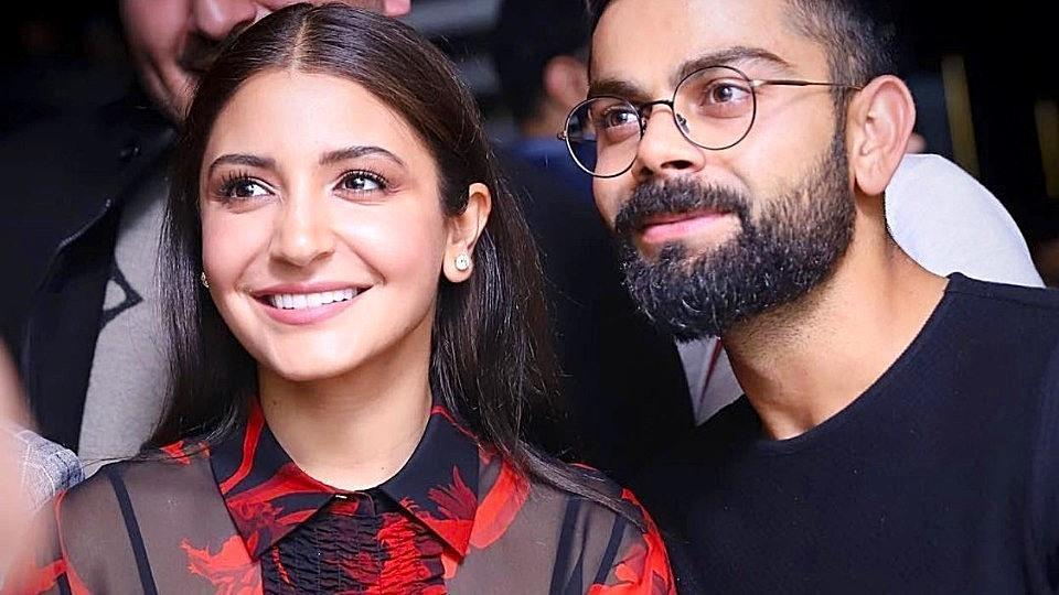 Anushka Sharma opted for a sleek, non-cheesy, black and red blouse and trousers look, instead of wearing all-red or pink. (Instagram)