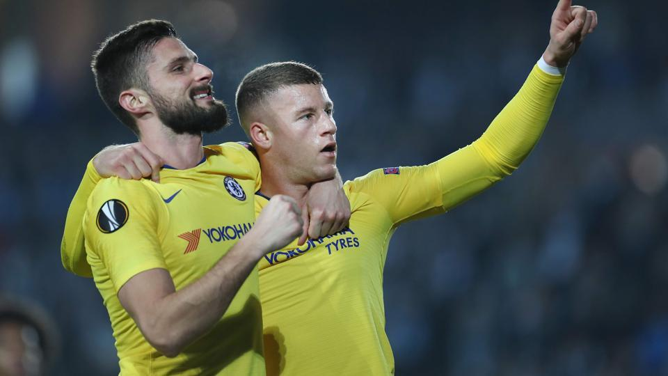 Chelsea's English midfielder Ross Barkley (R) celebrates scoring a goal with Chelsea's French striker Olivier Giroud.