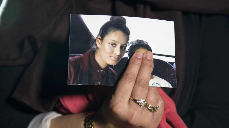 In this file photo taken on February 22, 2015, Renu Begum, eldest sister of missing British girl Shamima Begum, holds a picture of her sister while being interviewed by the media in central London.