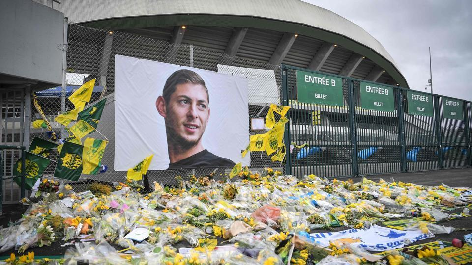 Yellow flowers are displayed in front of the portrait of Argentinian forward Emiliano Sala at the Beaujoire stadium in Nantes, France. File photo.