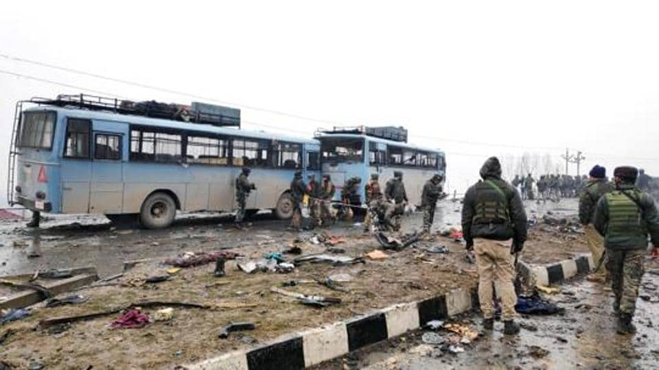 Indian soldiers examine the debris after an explosion in Lethpora in south Kashmir's Pulwama district February 14, 2019.