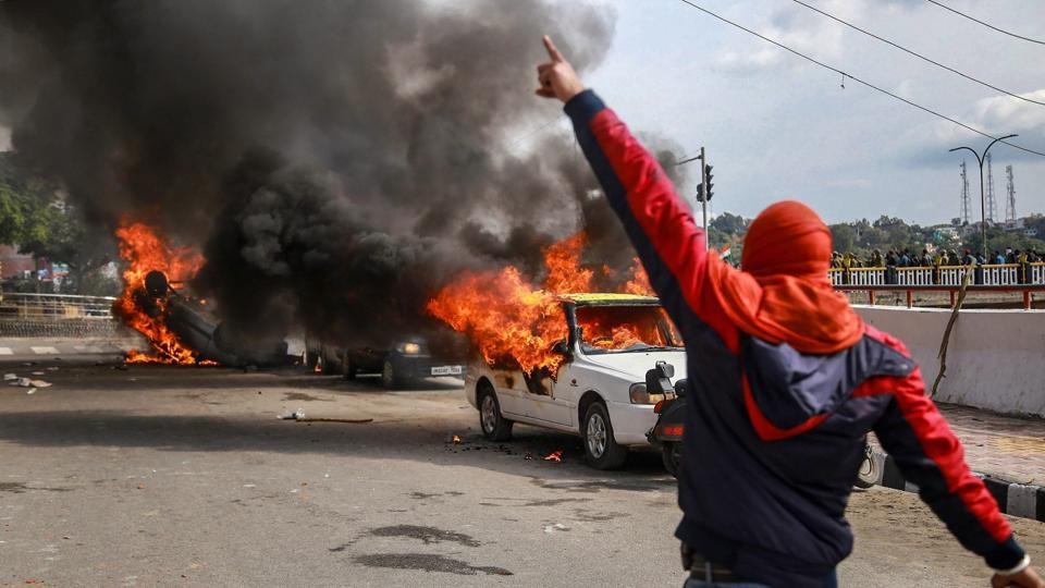 """Vehicles set on fire by protestors against the killing of 38 Central Reserve Police Force (CRPF) personnel in the Pulwama terror attack, in Jammu. """"Three youth were injured in the stone pelting and then the protesters went berserk and damaged around 15 to 20 vehicles. Later, some people from a particular community pelted stones at MES headquarters but the police parties reached in time and again fired teargas shells to disperse them,"""" said a police source. (PTI)"""