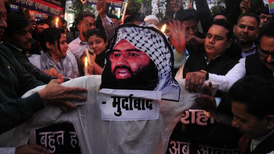 People burn an effigy of Jaish-e-Mohammed's leader Masood Azhar after an attack on security forces in Kashmir's Pulwama that left 43 soldiers dead and many others injured, in Lucknow, India, on Friday, February 15, 2019.