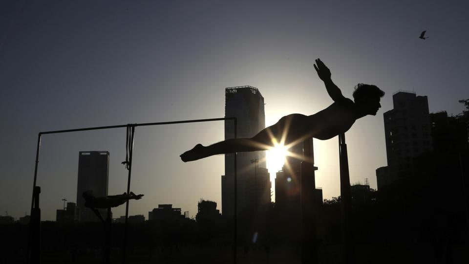 A player performs on a Mallakhamb pole during an early morning training session at Shivaji Park in Mumbai. The word mallakhamb comes from malla, meaning wrestler, and khamb, or pole, and is a traditional training exercise for wrestlers in India. After centuries of being practised in isolation in the subcontinent, mallakhamb is set to have its first international championship in Mumbai on February 16 and 17. (Rafiq Maqbool / AP Photo)