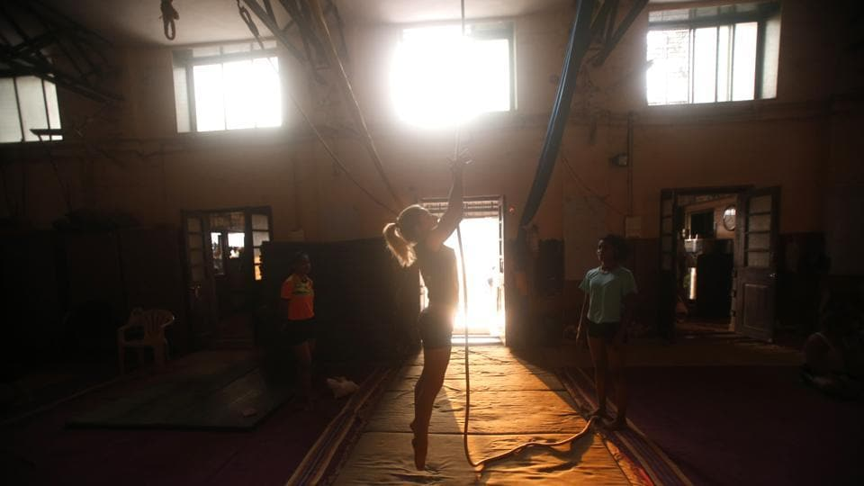 "Delia Ceruti, 36, an aerialist and physical performer from Italy, has been practicing mornings and evenings at Shivaji Park under Uday Deshpande, director and secretary general of the Vishwa Mallakhamb Federation. ""I am used to physically demanding activities but I am learning completely new techniques,"" she said. (Rafiq Maqbool / AP Photo)"