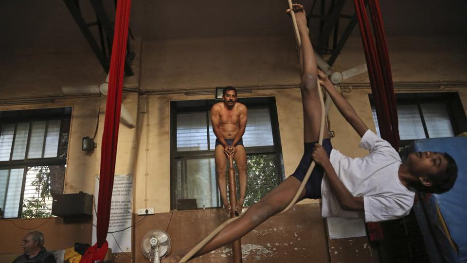 Like yoga, the time has come for mallakhamb to be shared with people across the globe, said Uday Deshpande. He further says that the sport has gained an international audience owing partly to reality television shows such as India's Got Talent where mallakhamb performers have won popularity. Cirque du Soleil's show Bazzar also features a mallakhamb performance.  (Rafiq Maqbool / AP Photo)