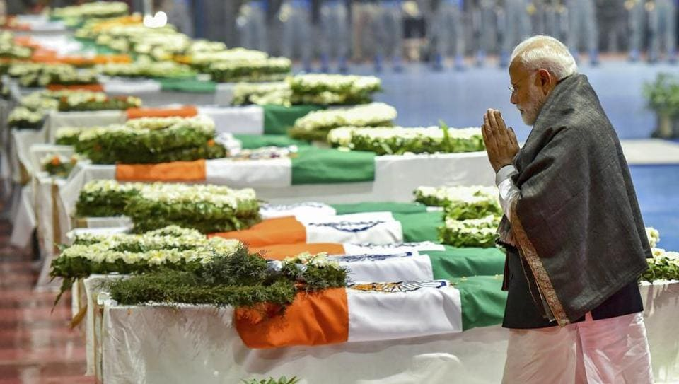 Prime Minister Narendra Modi pays tribute to the martyred CRPF jawans, who lost their lives in Thursday's Pulwama terror attack, after their mortal remains were brought at AFS Palam in New Delhi, Friday, Feb 15, 2019.
