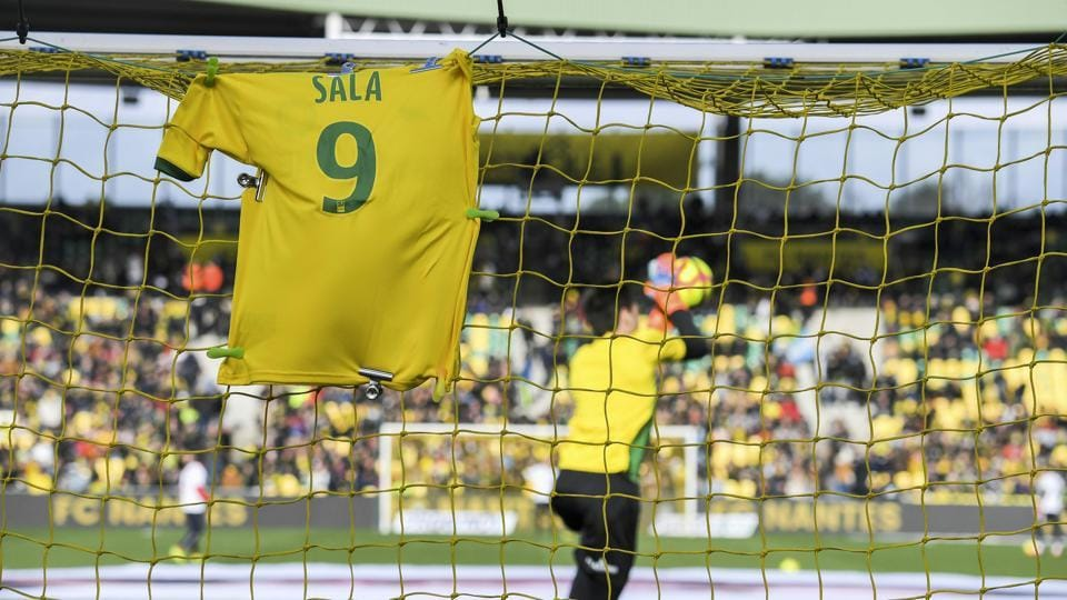A jersey is displayed on the goal in memory of late Argentinian forward Emiliano Sala.