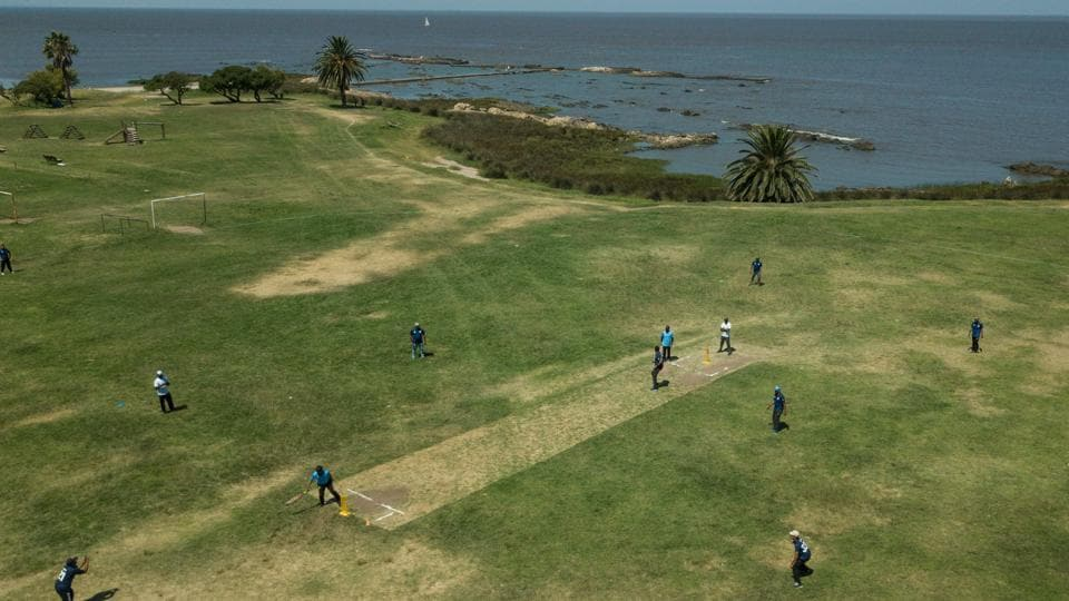 Aerial view of a cricket match played by Indians living in Uruguay, along Montevideo's seaside promenade, on February 10, 2019.
