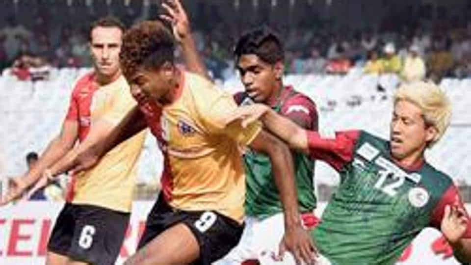 File Picture: East Bengal player Willis Deon Plaza and Mohun Bagan player Luis Xavier Barreto compete for the ball during I-League Derby match at Salt Lake in Kolkata on Sunday