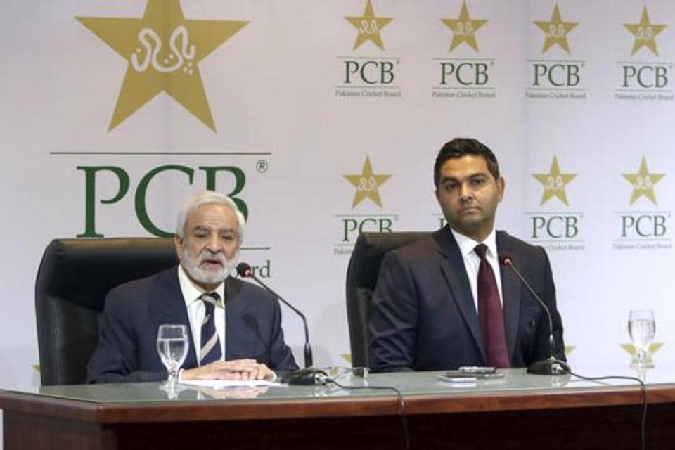 Pakistan Cricket Board's new managing director Wasim Khan, right, looks on during a press conference with the PCB chairman Ehsan Mani in Lahore, Pakistan.