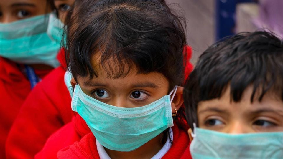 Students, wearing masks as protection against Swine Flu.