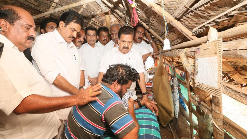 The opposition Congress has called a 12-hour shutdown in Kerala on Monday to protest the killing of two Youth Congress workers in north Kerala's Kasargode district. Kripesh, 21, died on the spot and Sharath Lal, 24, succumbed to his injuries in a hospital in neighbouring Mangaluru. Here seen, Ramesh Chennithala, KC Venugopal, MK Raghavan and other leaders at Kripesh's home. (HT Photo)