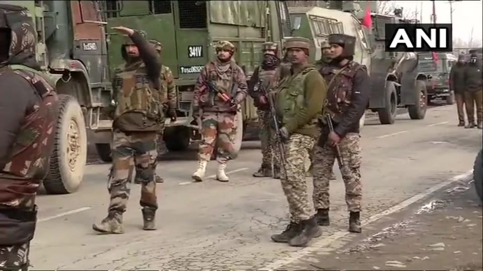 Soldiers take guard in Pingilana village after an encounter in Pulwama district of Jammu and Kashmir on Monday, days after a major attack in the district killed at least 40 CRPF personnel.