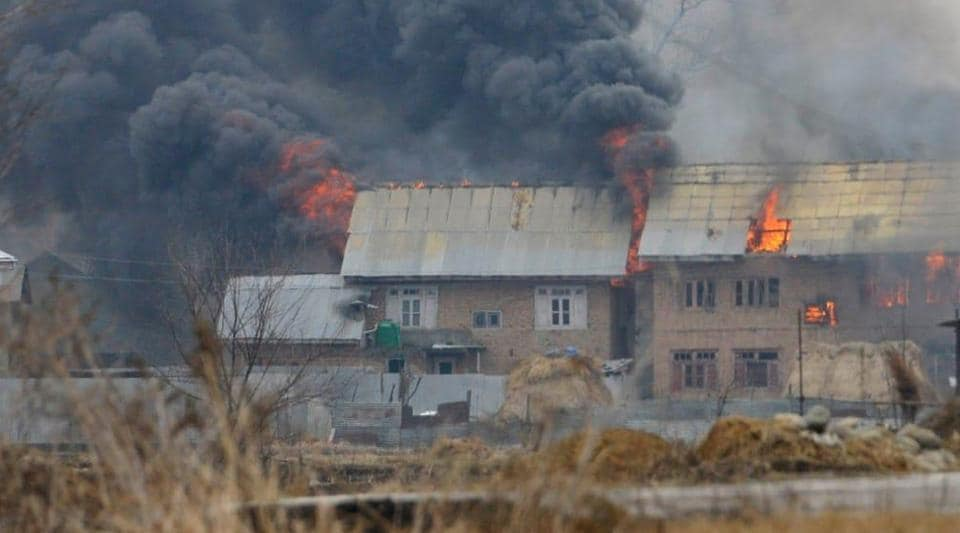 Smoke erupting from the house where terrorists had taken refuge in Pingilana village in south Kashmir's Pulwama districton February 18.
