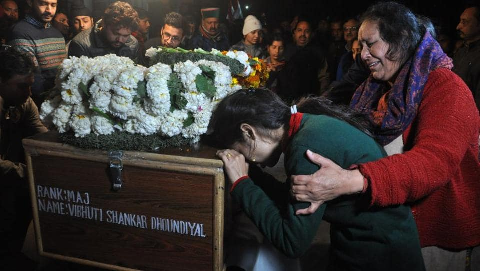 Family members of Major Vibhuti Shankar Dhoundiyal seen crying near his coffin during the wreath-laying ceremony, in Dehradun on February 18.