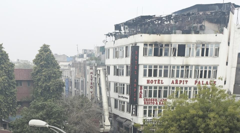 Firefighters seen outside Hotel Arpit Palace after fire broke out at the hotel, at Karol Bagh, in New Delhi, on Tuesday, February 12, 2019.
