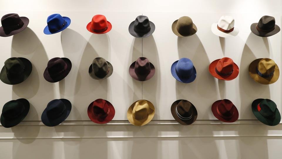 Hats are shown in a Borsalino store in downtown Milan, Italy. If the traditional Italian hat-maker Borsalino was once synonymous with the fedora, its new private equity owners want to imbue the brand with cachet that extends to couture, sportswear and streetwear for women and millennials -- without alienating its classic customers and the silhouette that helped shape the rough-and-tumble images of Robert Redford, Frank Sinatra and, perhaps no one more than, Humphrey Bogart. (Antonio Calanni / AP Photo)