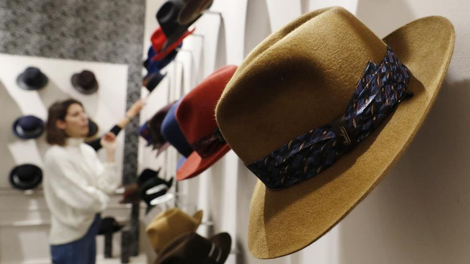 "A woman looks at hats in a Borsalino store in downtown Milan. ""Borsalino should be the leader of the hat business,"" Santucci said. ""The power of the brand is going to stay forever."" (Antonio Calanni / AP Photo)"