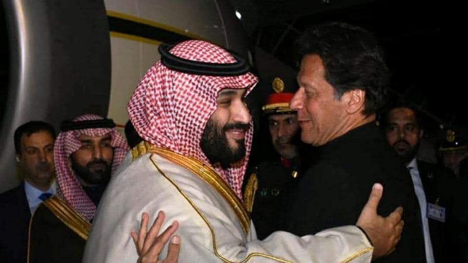 Pakistani Prime Minister Imran Khan greets Saudi Arabia's Crown Prince Mohammed bin Salman on his arrival at Pakistan Air Force's Nur Khan Base in Rawalpindi.