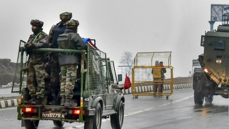 Army soldiers move towards the site of suicide bomb attack at Lathepora Awantipora in Pulwama district of south Kashmir on February 14.