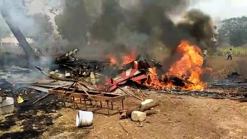 Two aircrafts of Indian Air Force's Surya Kiran Aerobatics Team collided at the Yelahanka airbase in Bengaluru. The aircrafts, believed to be BAE Hawk MK 132, were rehearsing for the Aero India show that was to begin tomorrow. Both the pilots ejected but one of them succumbed to his injuries. (PTI)