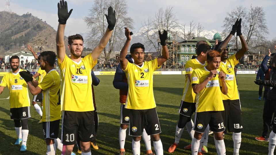 Real Kashmir's players wave to fans after winning their I-League club football match against Chennai City FC.