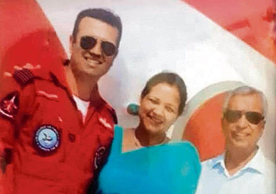 Sudesh Gandhi (C) and Madan Mohan Gandhi (R), parents of Wing Commander Sahil Gandhi (L), who was killed in the mid-air crash.