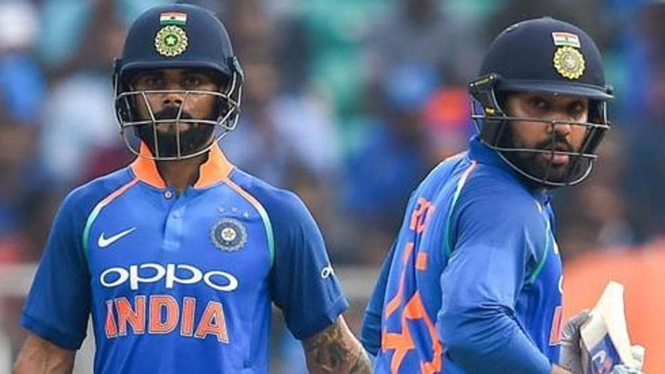 Virat Kohli and batsman Rohit Sharma run between the wickets during the 5th and final ODI cricket match against West Indies.
