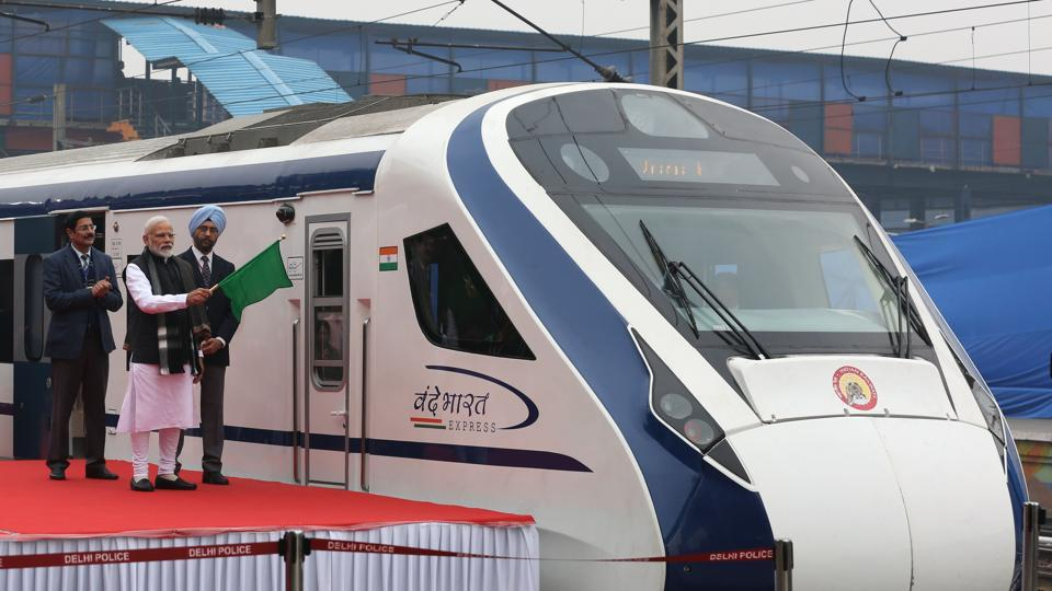 Prime Minister Narendra Modi (2nd L) flags off India's first semi-high speed express train Vande Bharat Express at New Delhi Railway Station on February 15.