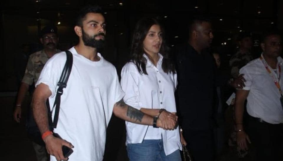 Virat Kohli and Anushka Sharma at the airport on Tuesday.