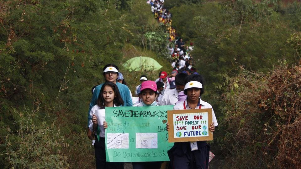 Students from Gurugram schools protest against the proposed six-lane highway through Gurugram's Aravalli Biodiversity Park.