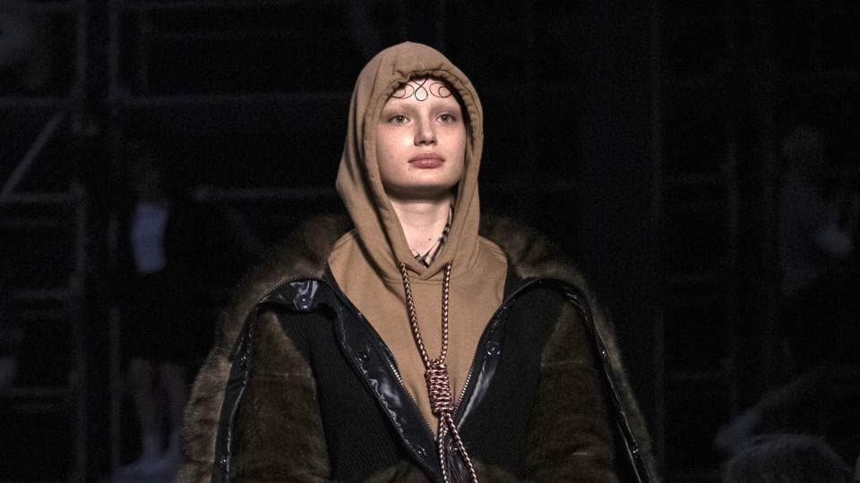A model wearing a creation by Burberry at the Autumn/Winter 2019 fashion week runway show in London. The chief executive and chief creative officer of luxury powerhouse Burberry have apologized for putting a hoodie with strings tied in the shape of a noose on their London Fashion Week runway.