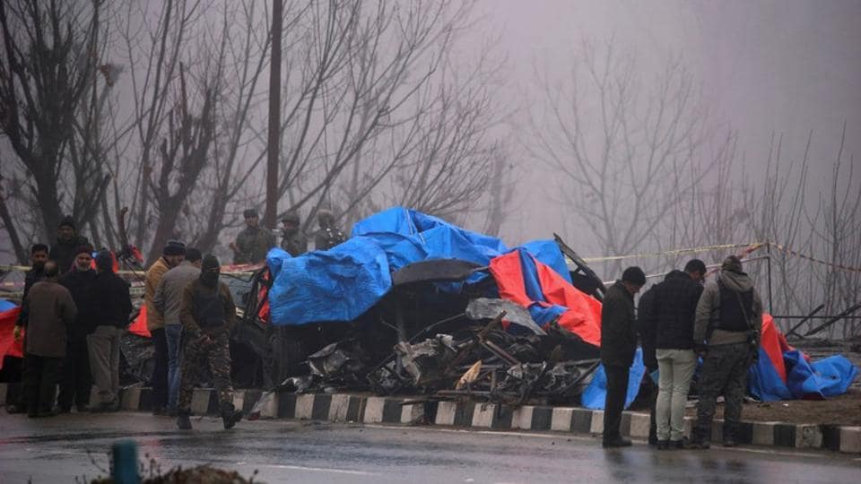 Forensic officials inspect the wreckage of a bus after a suicide bomber rammed a car into the bus carrying Central Reserve Police Force (CRPF) personnel on Thursday, in Lethpora in south Kashmir's Pulwama district, February 15, 2019.