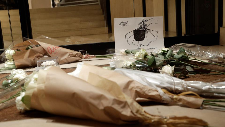 Flowers are laid in tribute to late German fashion designer Karl Lagerfeld outside the French fashion house Chanel, in Paris on Tuesday.