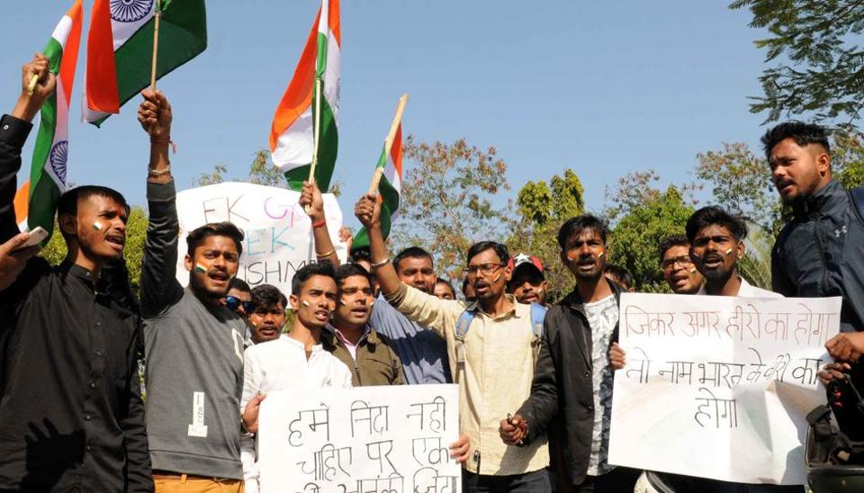Public using Tricolour to protest against the Pakistan before the arrival of coffin of Pulwama martyr CRPF Jawan Vijay Soreng at Birsa Munda airport