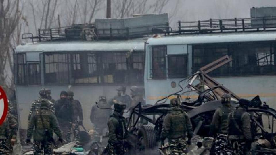 Security men inspect at the site blast in Lethpora area of south Kashmir' s Pulwama district  on February 14.