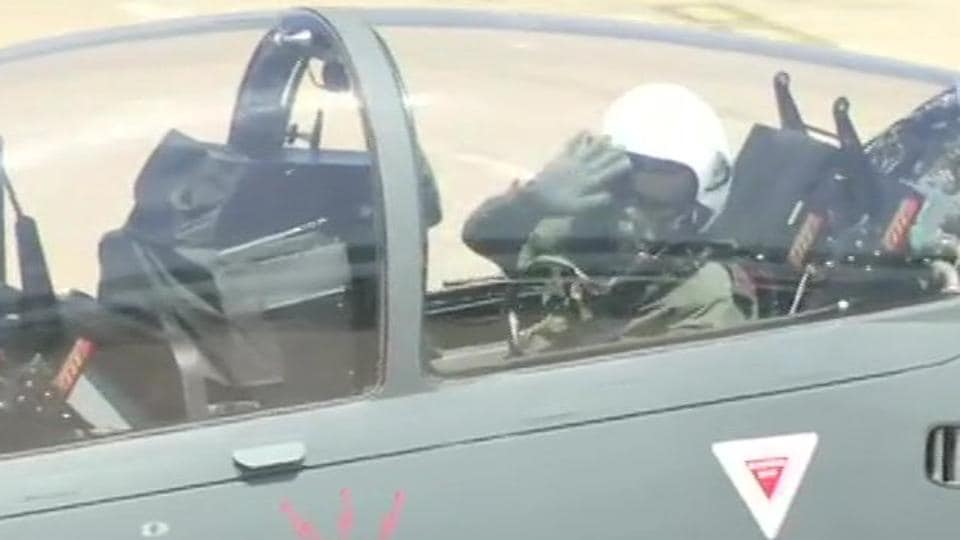 Army chief General Bipin Rawat waives at the crowd before taking off in light combat aircraft Tejas at the Aero India 2019 show in Bengaluru on Thursday.
