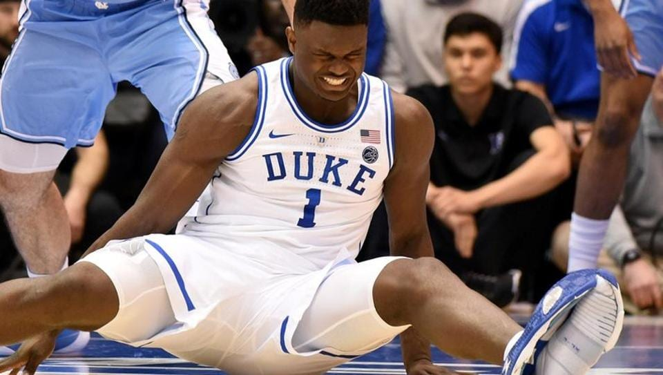 Duke Blue Devils forward Zion Williamson  reacts after his Nike shoe gives in.
