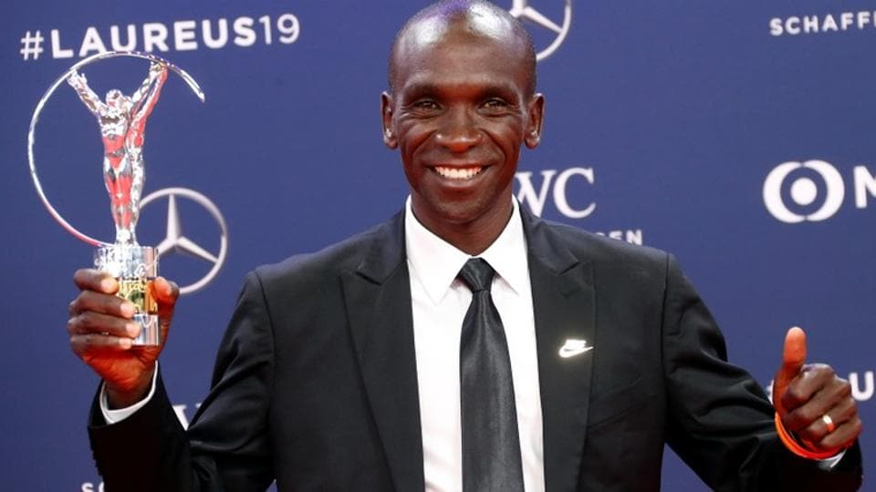 Eliud Kipchoge poses after winning the Exceptional Achievement Award at the Laureus World Sports Awards.