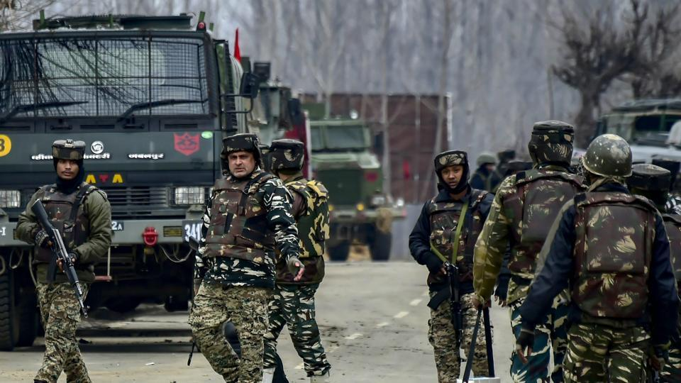 Pulwama: Security forces' personnel sanitize the area during a gunbattle with the militants in which the top commander of the Jaish and Lethpora attack mastermind Kamran was killed along with his associate Hilal Ahmad, a local recruited by the terror group, at Pinglan area of Pulwama in south Kashmir, Monday, February 18, 2019. Four Army personnel, including a Major, were also martyred in the encounter. (PTI Photo/S Irfan) (PTI2_18_2019_000200B)