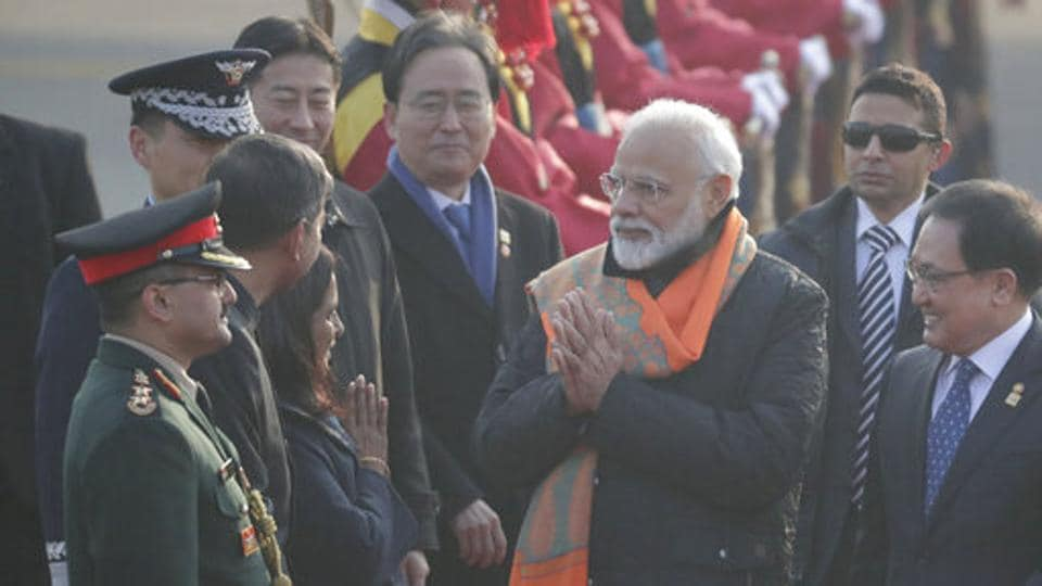 Prime Minister Narendra Modi, center, greets upon his arrival as South Korean Minister of Science and ICT You Young Min, right, looks at the Seoul airport in Seongnam, South Korea, Thursday, Feb. 21, 2019.