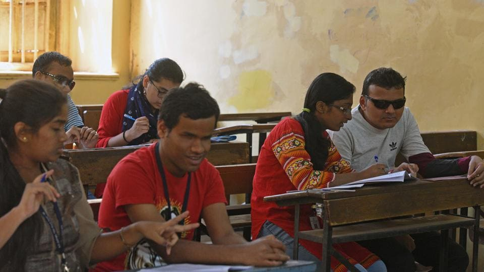 Visually challenged students, with their writers in examination hall  at SP college as HSC exams commence in the state. (Pratham Gokhale/HT Photo)