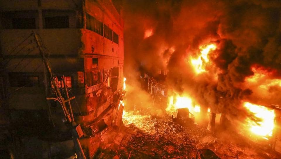 Flames rise from a fire in a densely packed shopping area in Dhaka, Bangladesh on Wednesday. The fire that killed at least 67 people in the oldest part of the Bangladeshi capital shows the lapses in public safety that still plague the South Asian country despite its rapid economic growth. (Zabed Hasnain Chowdhury / AP)