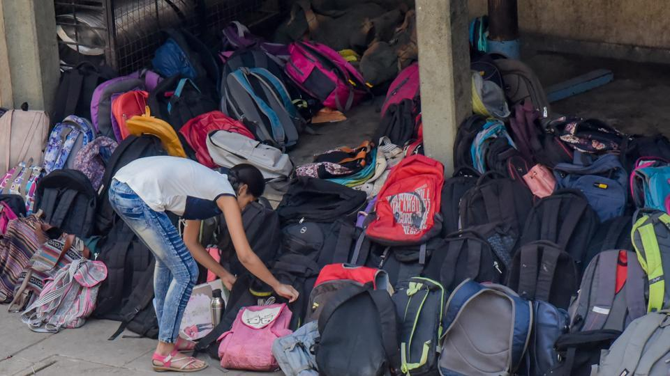 A student is seen keeping her bag outside the exam centre before entering.  (Sanket Wankhade/HT PHOTO)
