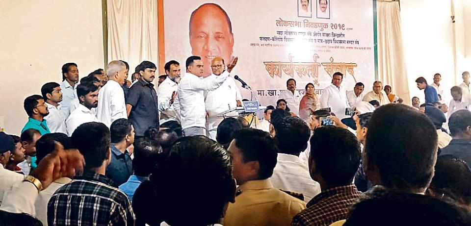 NCP workers shout slogans against each other at party supremo Sharad Pawar's rally in Madha, near Satara, on Friday. The factions were led by two NCP leaders - Shekhar Gore and Kavita Mhetre.