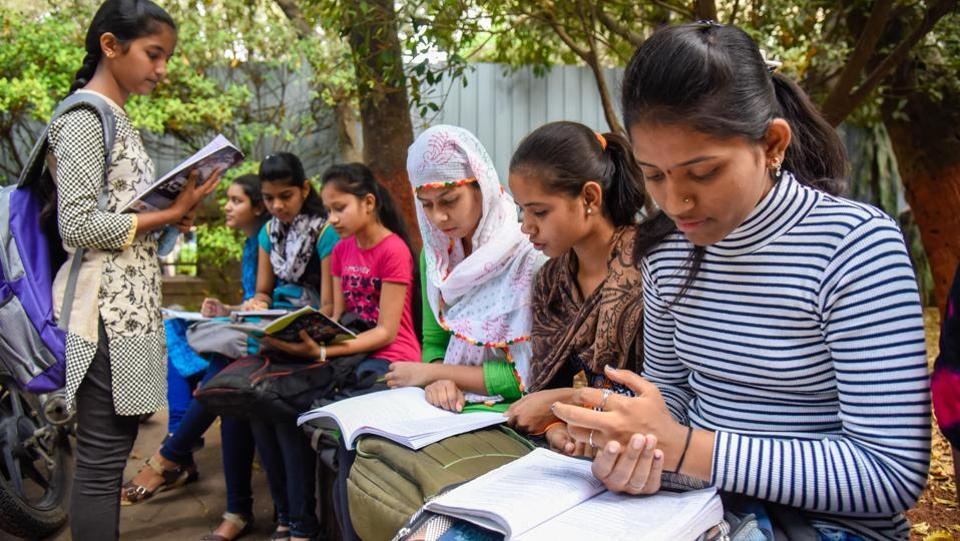Students spotted outside the examination centre, revising for the examination.  (Sanket Wankhade/HT PHOTO)