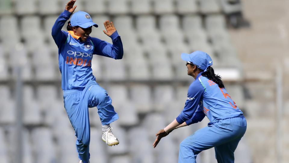 Ekta Bisht, left, and Jemimah Rodrigues celebrate India's win over England.
